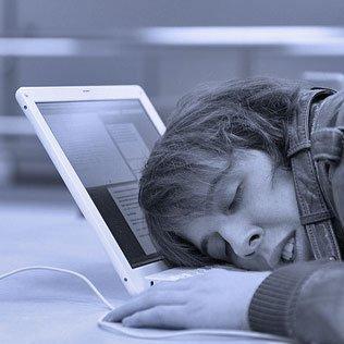 woman with head on laptop keyboard, asleep