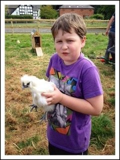 lad with hen