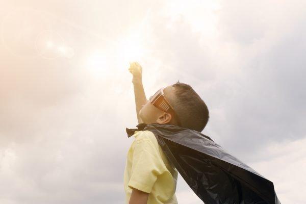 Photo of boy pretending to be a superhero