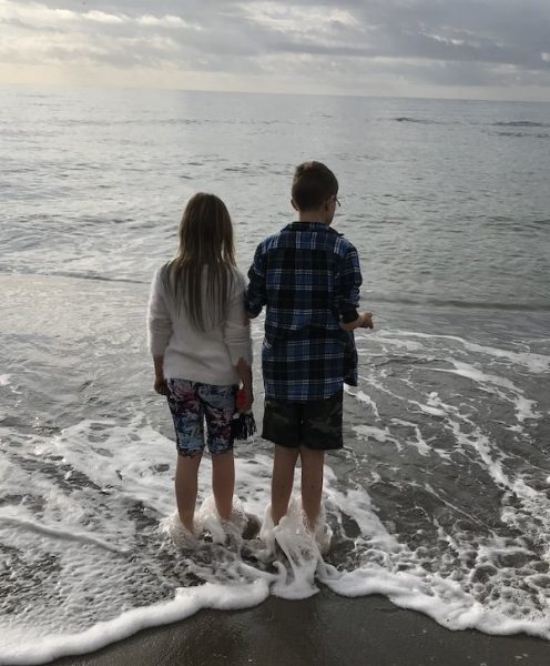 Two children paddling in the sea