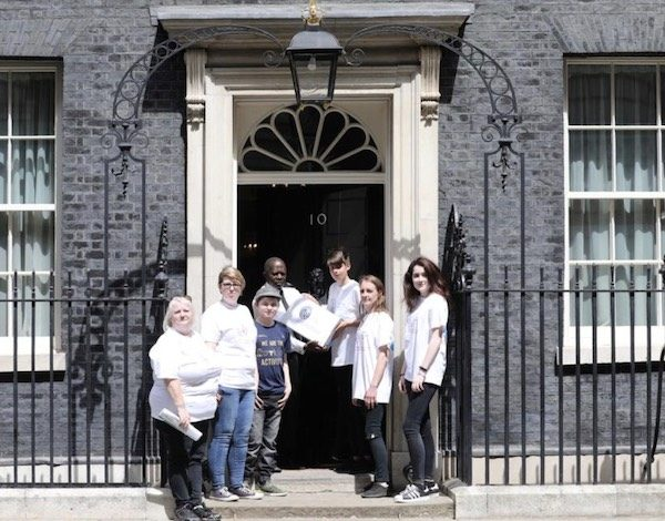 Poppy Rose and team and SNJ columnist and neurodiversity campaigner, Siena Castellon giving the 15,000 signature into to No Downing Street.