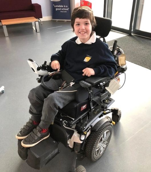 Dominic in his powerchair