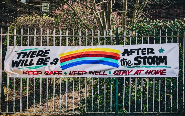 banner saying there will be a rainbow after the storm